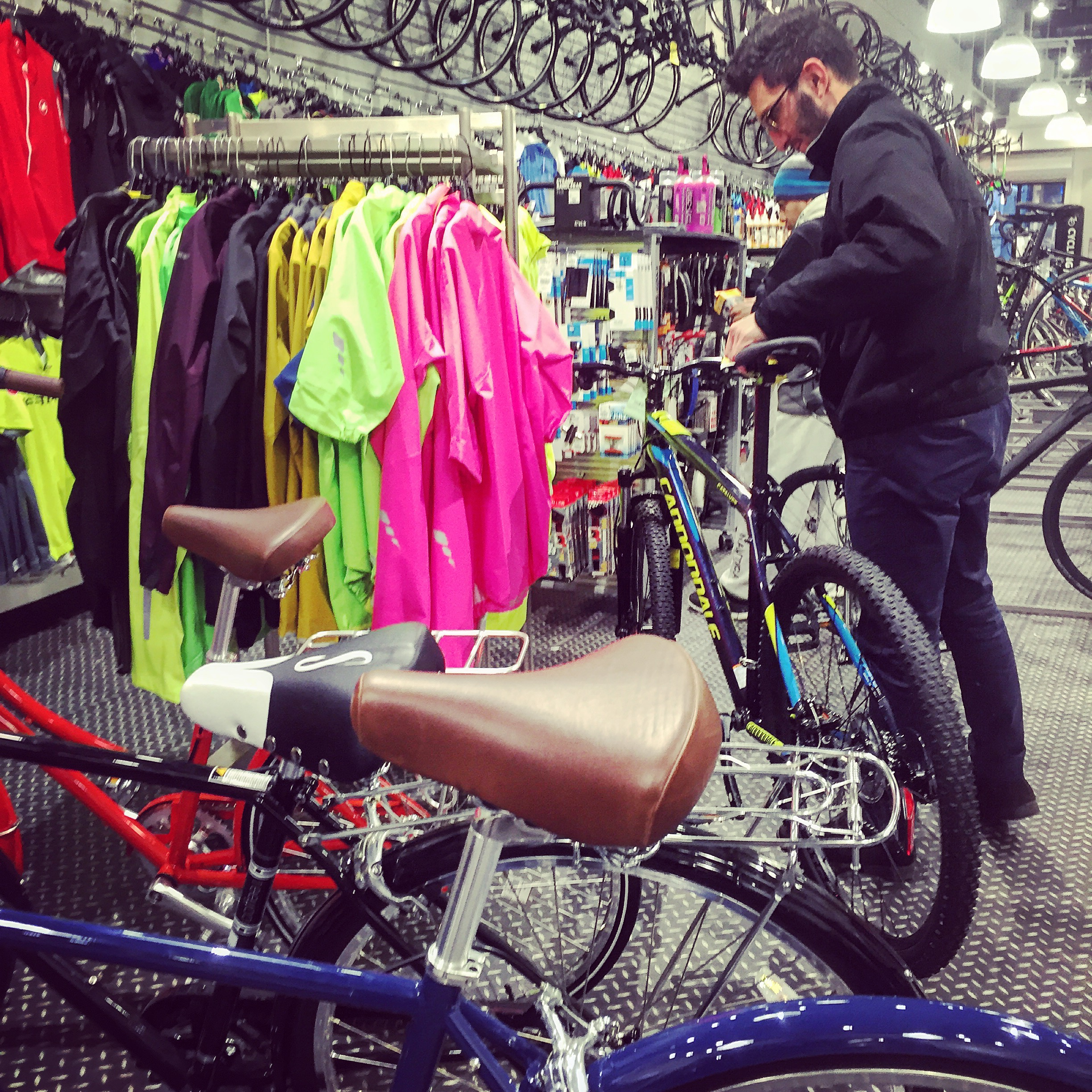 A customer inspects a bike. When it comes to sporting goods, users need to try out the products and be highly reassured they are the right products to purchase for them.