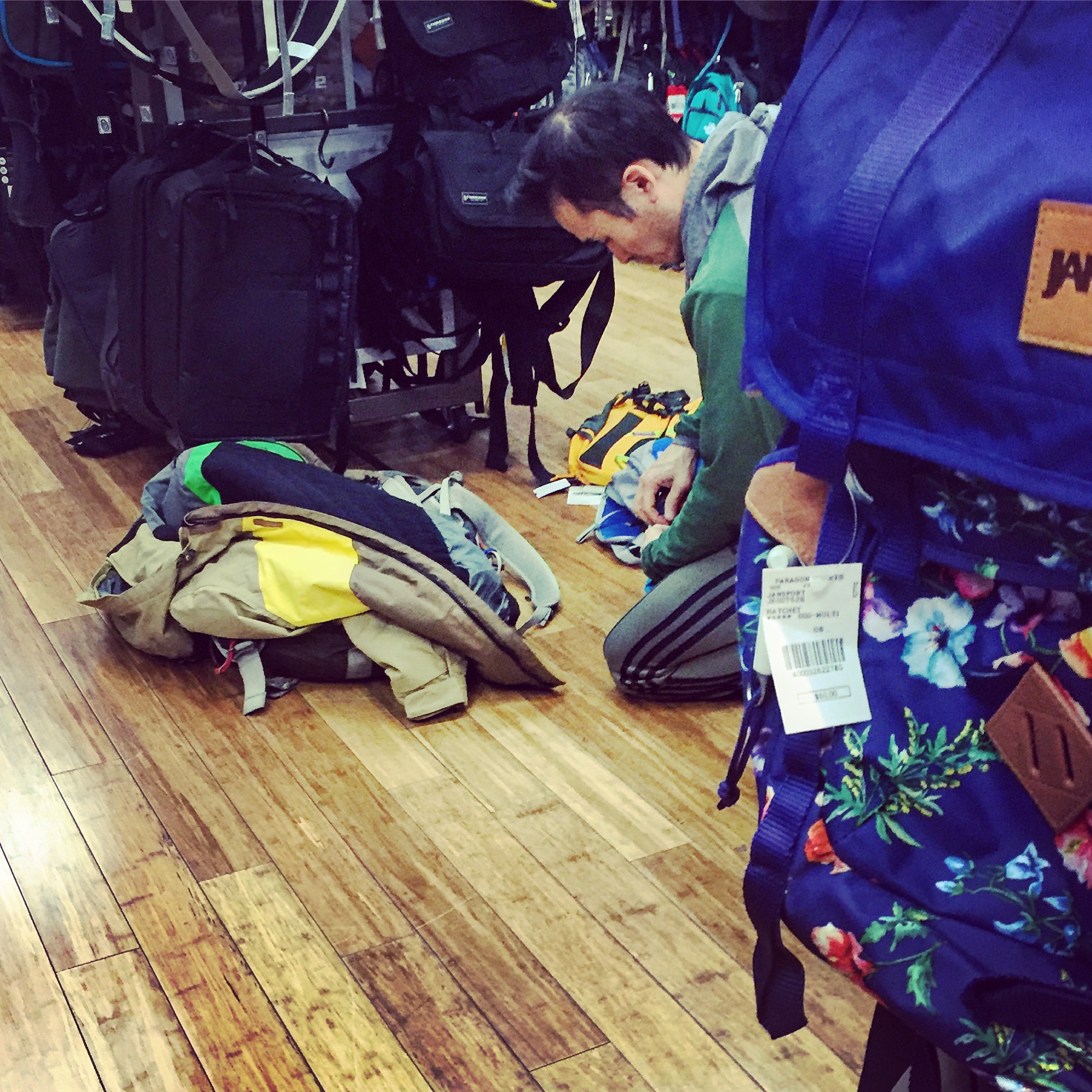 Another customer tests the backpacks.