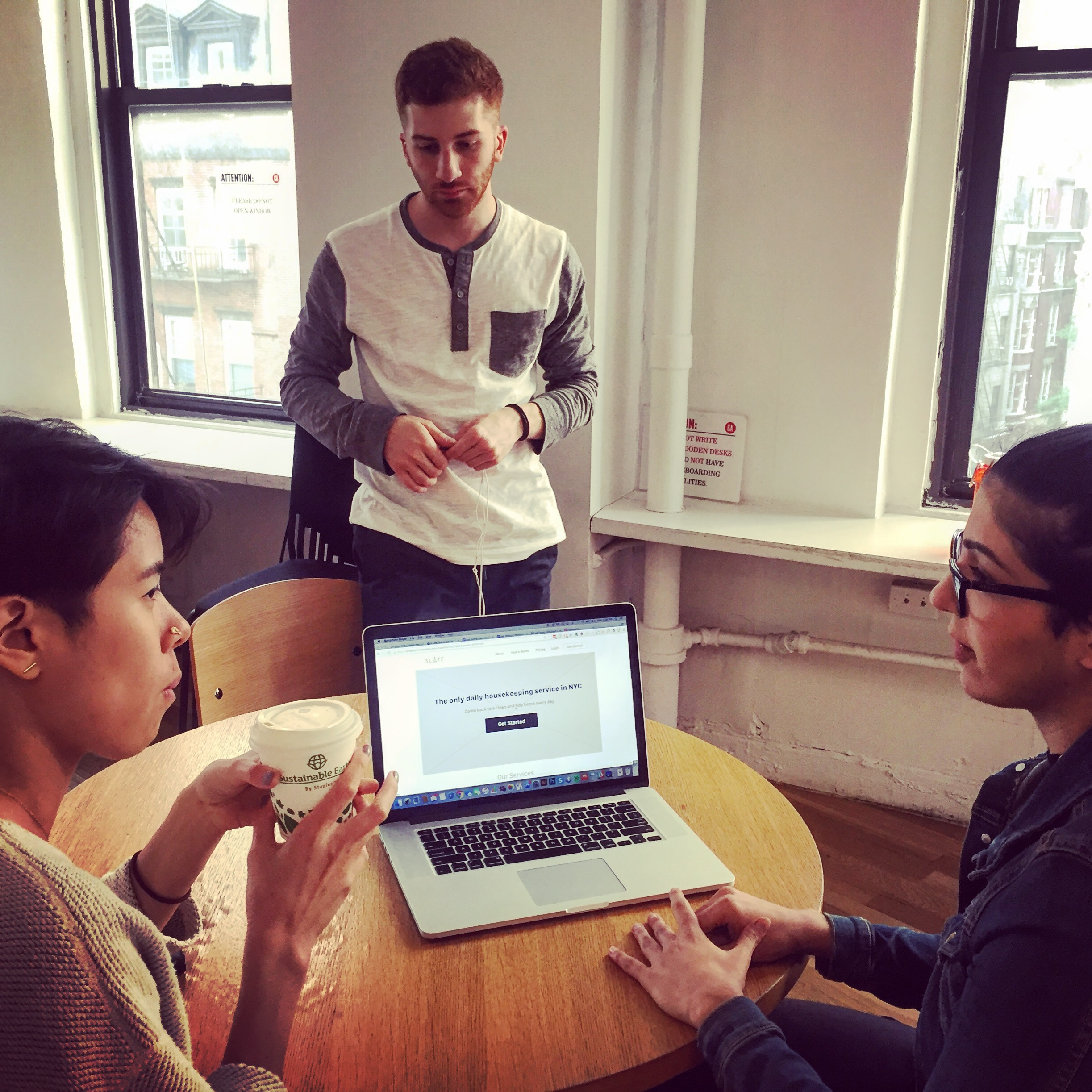Mor (right) and Anthony (center) talk with a user after they work through some scenarios on the first iteration of our Slate site redesign.