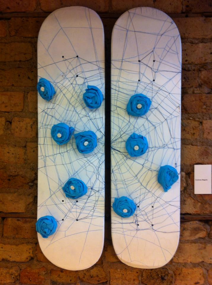Love Catcher, Blue Roses and Spider Web - Medium: used skateboard, spray paint, thread, crepon paper, buttons - Corinne Séguin (2013)
