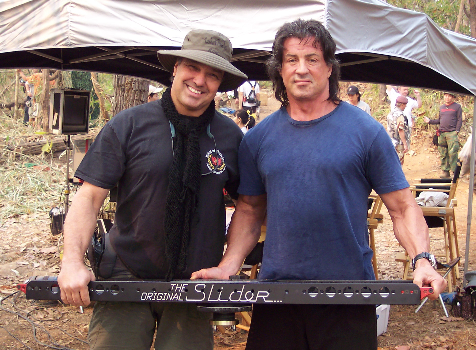 "Ron and Sly Stallone on the set of John Rambo, in Northern Thailand. Sly is holding up our ""Original"" Slider"