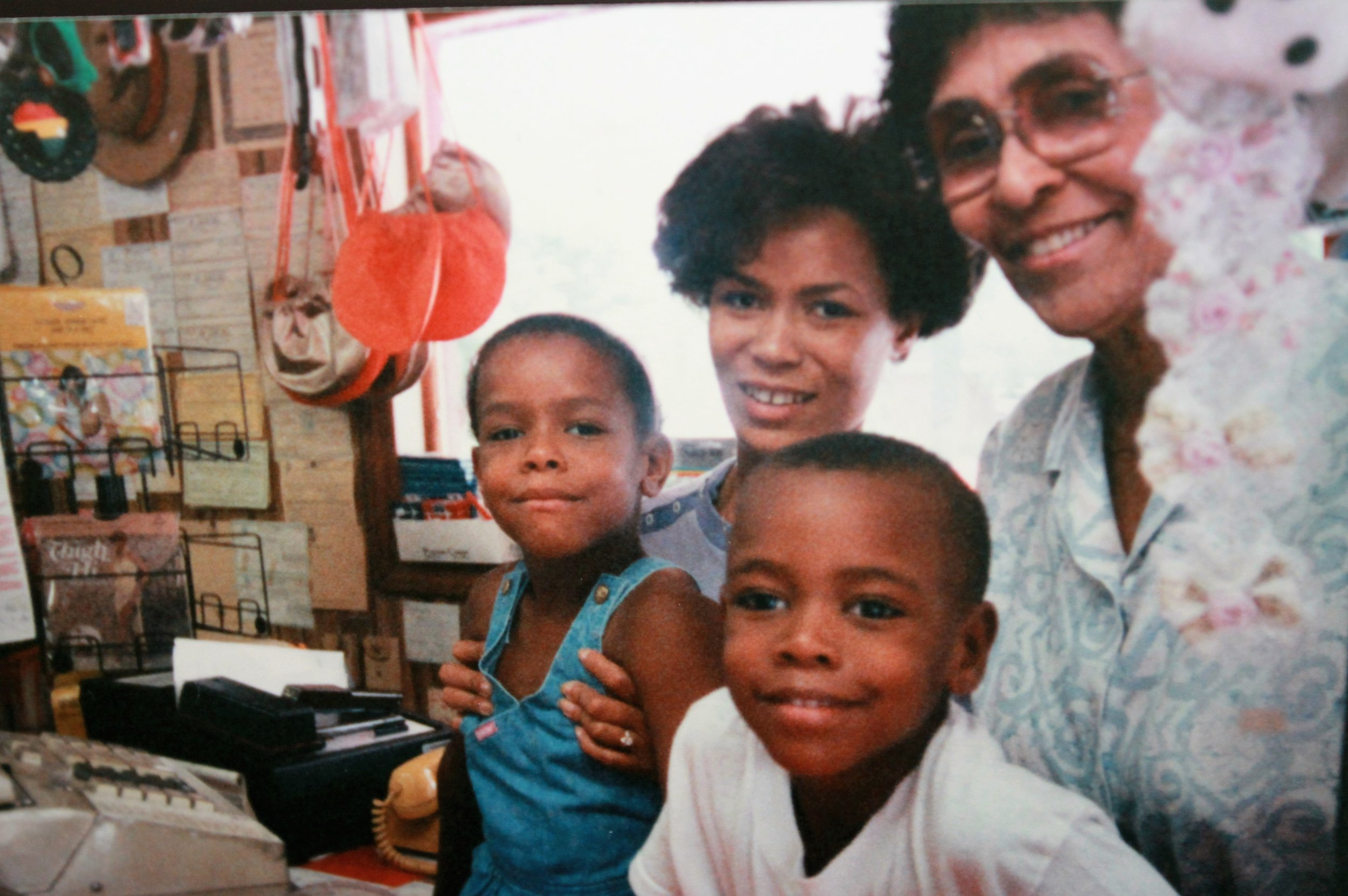 "Picture of my family (including me on the left in blue) at my grandmother's store. Although I didn't realize it at the time, these early days and experiences shaped my work ethic and my desire to do things the right way and to the best of my ability, or not at all. Anything less than my best effort (or if my snack breaks ran a little too long) I could expect to hear my grandmother semi-jokingly say "" You're going to get fired before you can even get hired ."" She would also often say: "" If a task has once begun, never leave it till it's done. Be the labor great or small, do it well or not at all. "" This has always stayed with me."