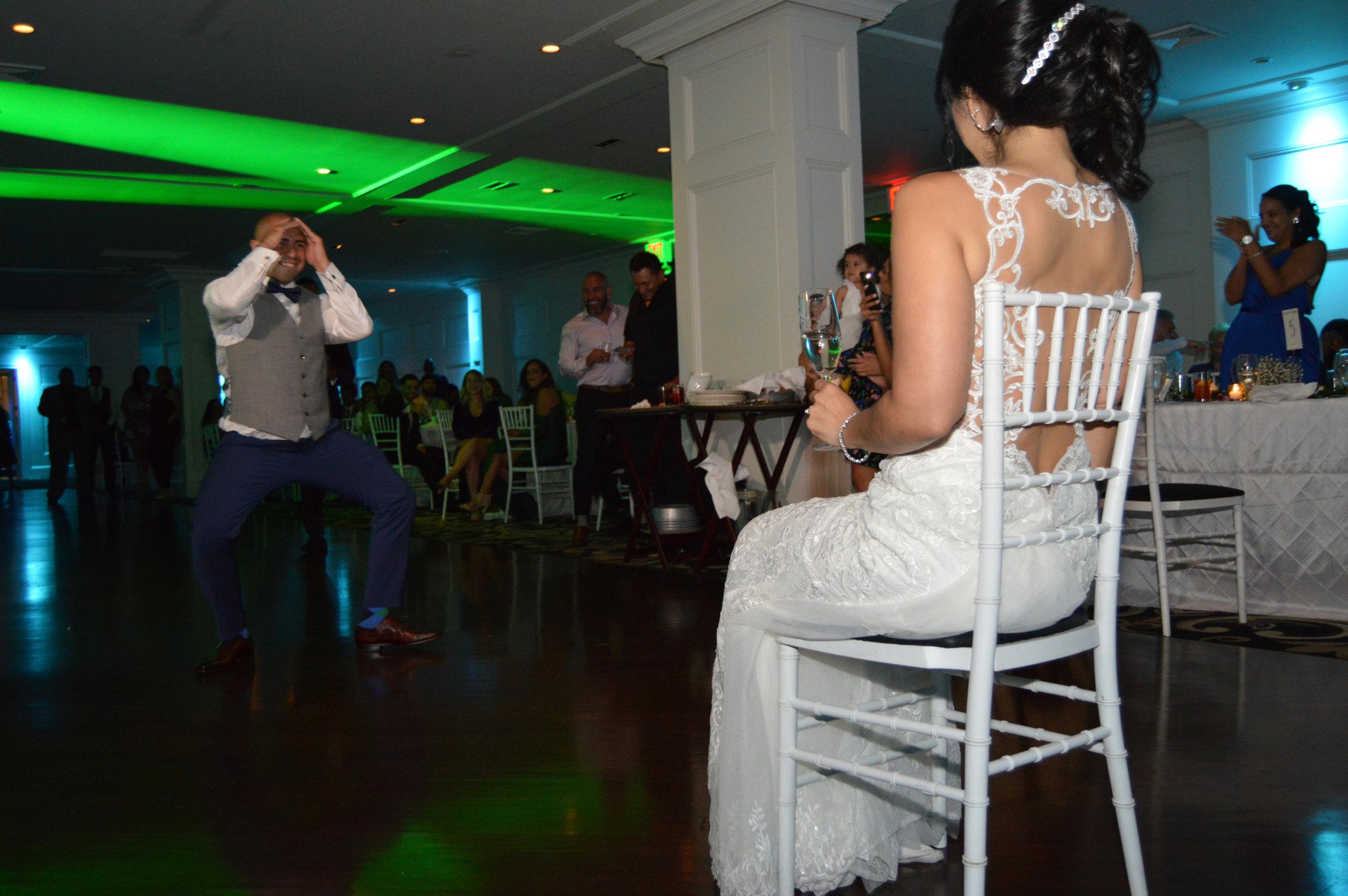 Garter Removal | Groom dance | Groom garter removal dance | wedding reception fun ideas | fun ideas wedding party | www.anajacqueline.com