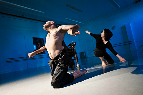 [IMAGE - Dancers on the floor, arms spread, heads facing upward. Neil Marcus, Olimpias , 2009]