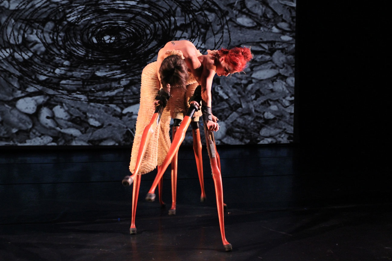 IMAGE - Dancers poised wearing sculptural prosthetic limbs.Lisa Bufano and Sonsheree Giles, One Breath Is An Ocean For a Wooden Heart ,AXIS Dance Company  in association with Alliger Arts,2008. Photograph by Jason Tschantré.