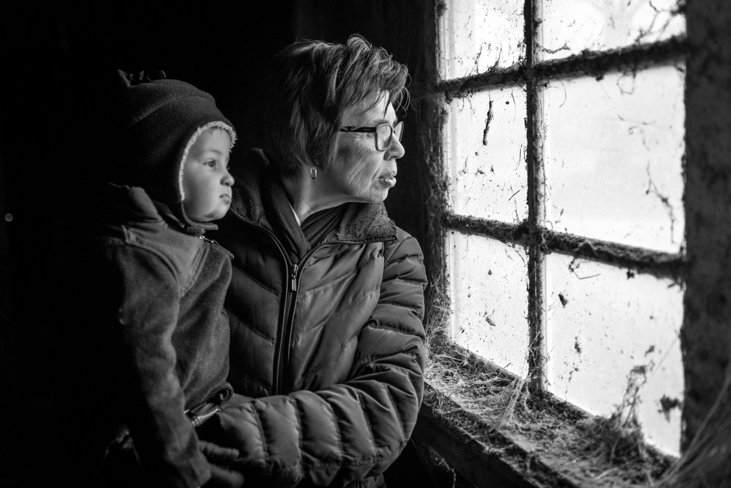 This fall we made a trip to a local farm to see some puppies, chickens and sheep. It was quite an adventure. We enjoyed petting the adorable golden retriever puppies in the middle of this dark and dingy barn. This picture was made as Sharon was looking out the window with Clayton. Sharon grew up on a farm and spent many hours in barns just like this one. This reminds me of the importance of passing on our life experiences to the next generation. How will they know if we don't show them?