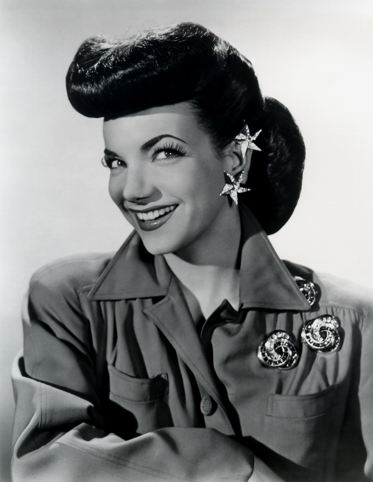 Actress and singer Carmen Miranda became the greatest popularizer of Brazilian crossover music via film and Broadway performances in the late 1930s-mid 1940s. She is pictured here circa the 1940s without her iconic costumes and jewelry.