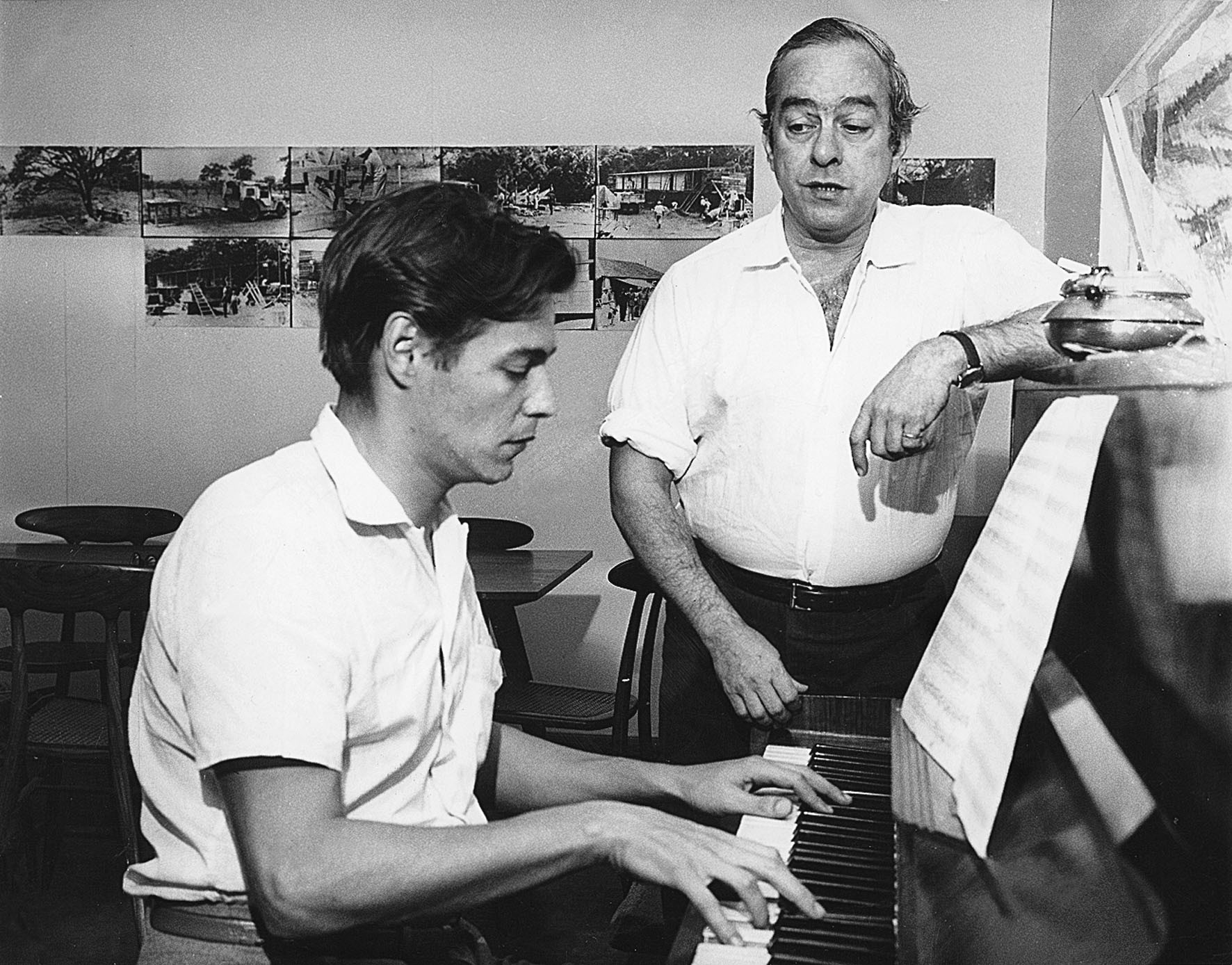 "Antonio Carlos (""Tom"") Jobim (seated at the piano), and poet, lyricist, and singer Vinicius de Moraes (standing) were some of the earliest composers of what became bossa nova."