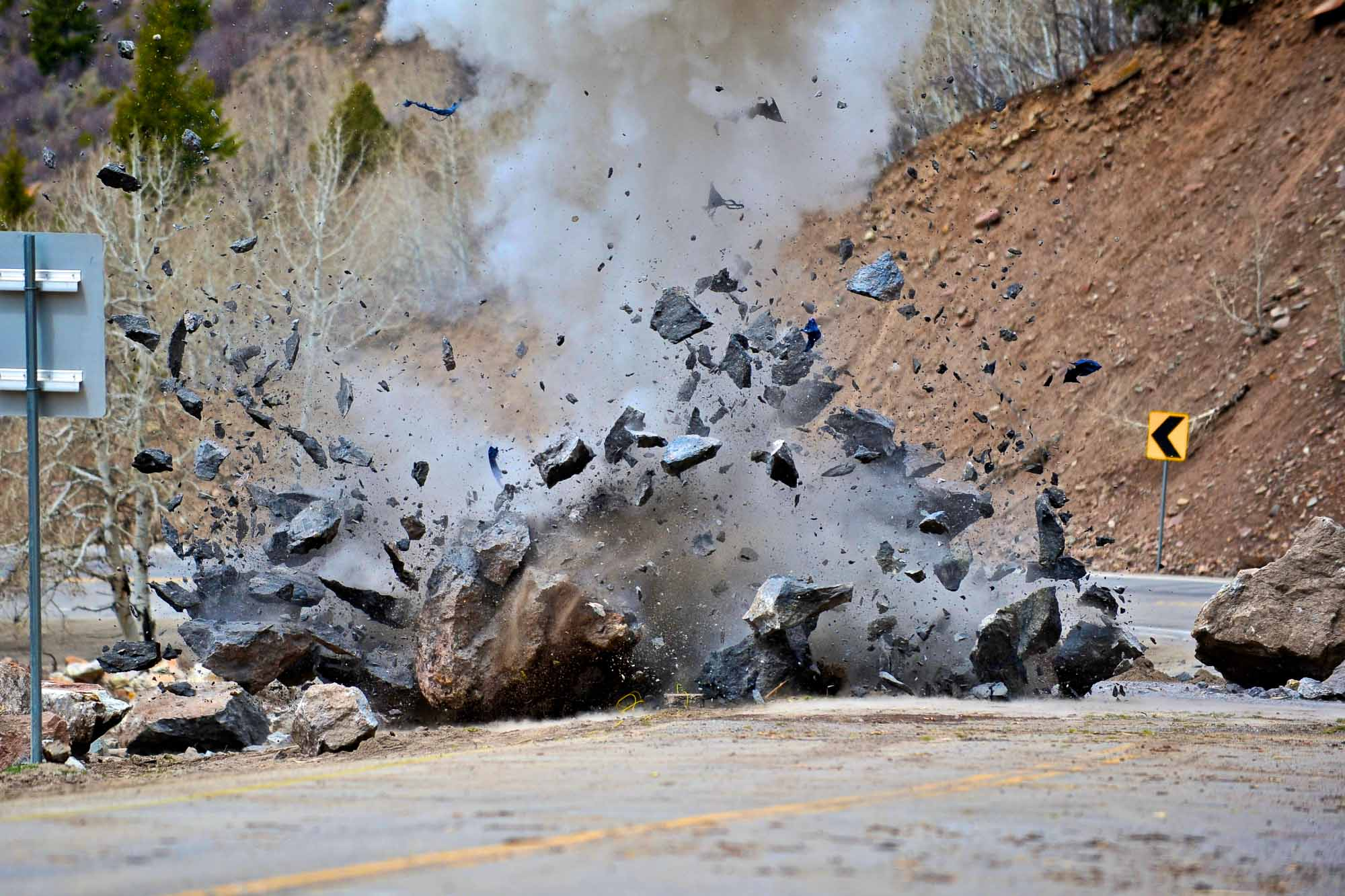 CDOT crew detonate a boulder on U.S. Highway 24 that fell during a rockslide on Tuesday, April 22, 2014. The slide happened off Battle Mountain between Minturn and Leadville, Colo. around 2:30 a.m.