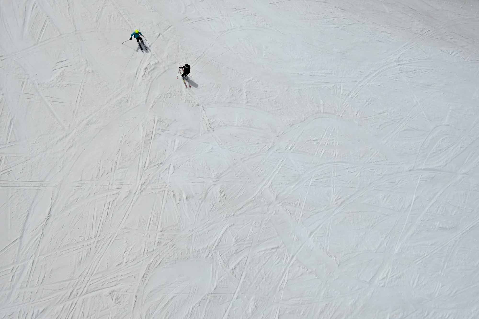 Two skiers have the slopes to themselves on Vail Mountain in Vail, Colo. at the end of the ski season on Friday, April 18, 2014.