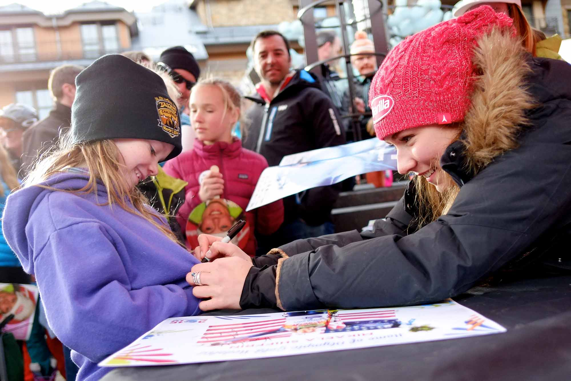 Kailey Thayer, 7, of Gypsum, Colo., smiles as she receives on her sweatshirt the autograph of Olympic gold medalist Mikaela Shiffrin in Vail, Colo. on Friday, March 28, 2014. Fans from the valley and around the world officially welcomed home the Olympian with a celebration.