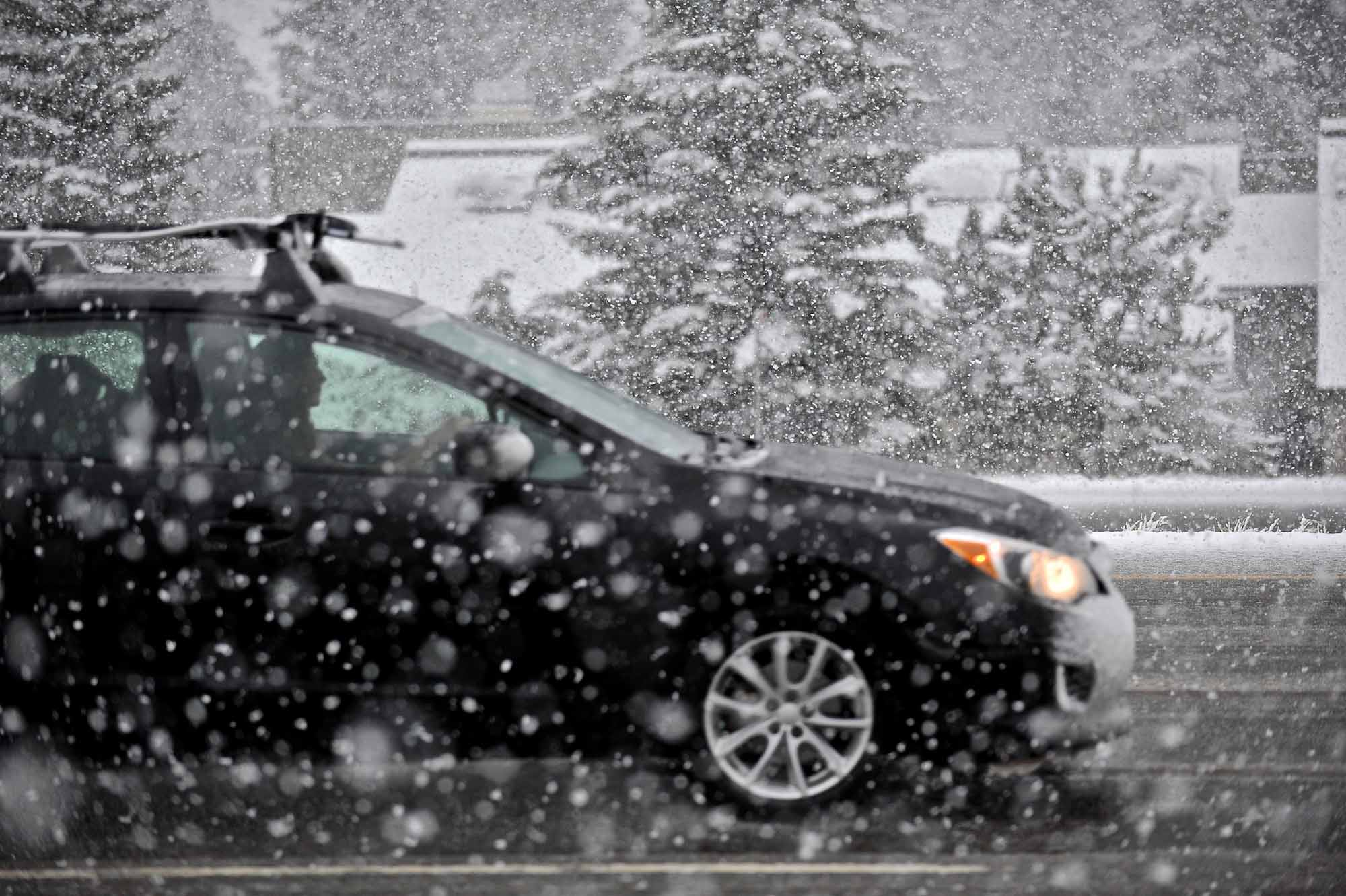 A driver travels west on I-70 during a snowstorm in Vail, Colo. on Sunday, May 11, 2014. The Mother's Day storm caused numerous accidents along the Interstate from Silverthorne to Gypsum.