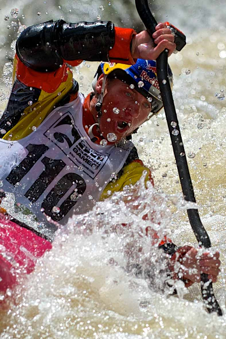Dane Jackson, of Walling, Tennessee, takes a breath and looks downriver as he paddles through his final run in the Steep Creek Championship at Homestake Creek outside Red Cliff, Colo. on Thursday, June 5, 2014. Jackson finished second with a time of 1:43.03.