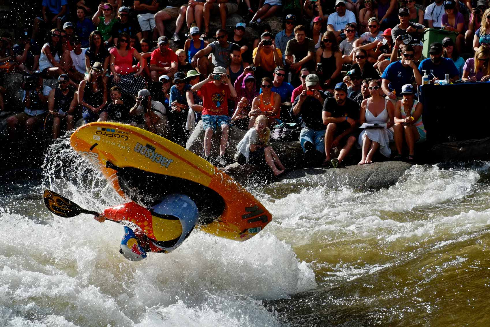 Dane Jackson, of Rock Island, Tennessee, competes in front of a crowd of hundreds during the GoPro Mountain Games' kayak freestyle finals in Vail, Colo. on Saturday, June 7, 2014. Jackson finished in first place.