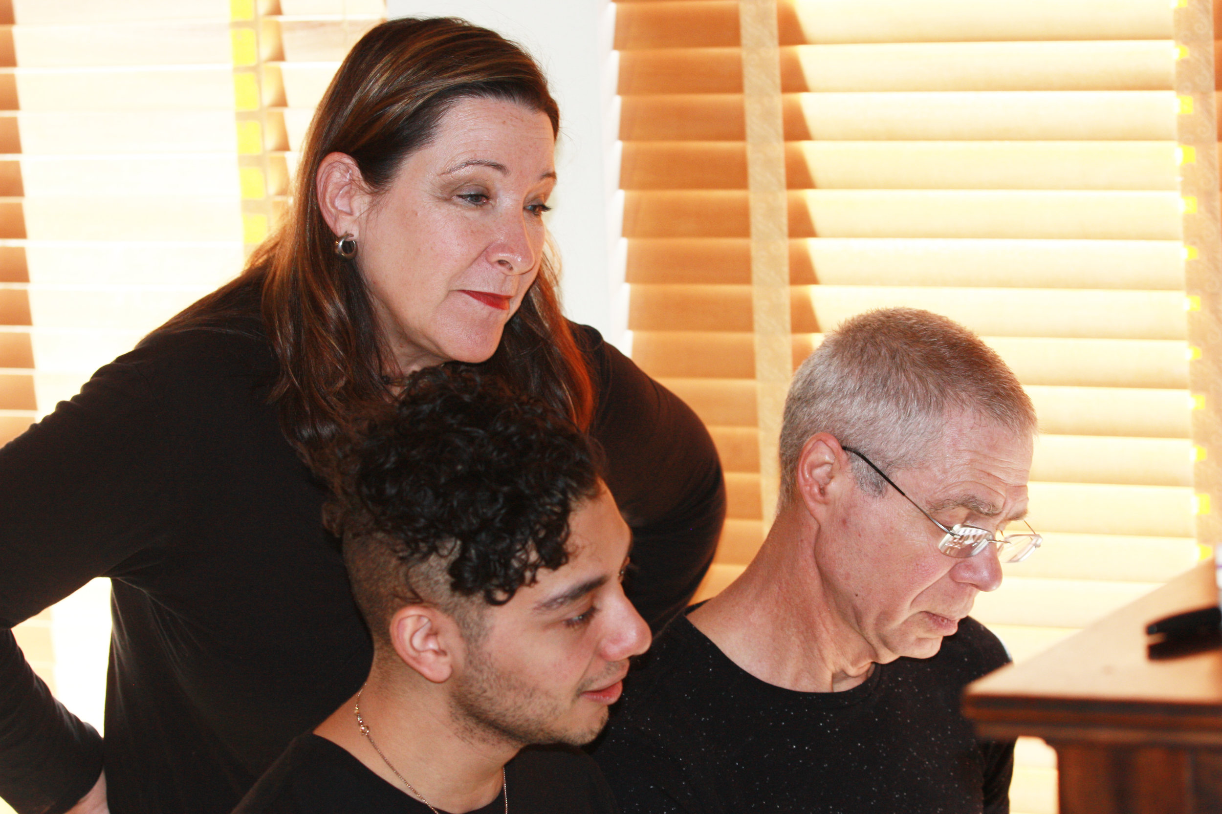 Cynthia Stokes, Director (standing), Joseph Waters, Composer (glasses) & Rodolfo Giron, Singer (seated) - Right Click to Download (Photo Credit Christian Teare)