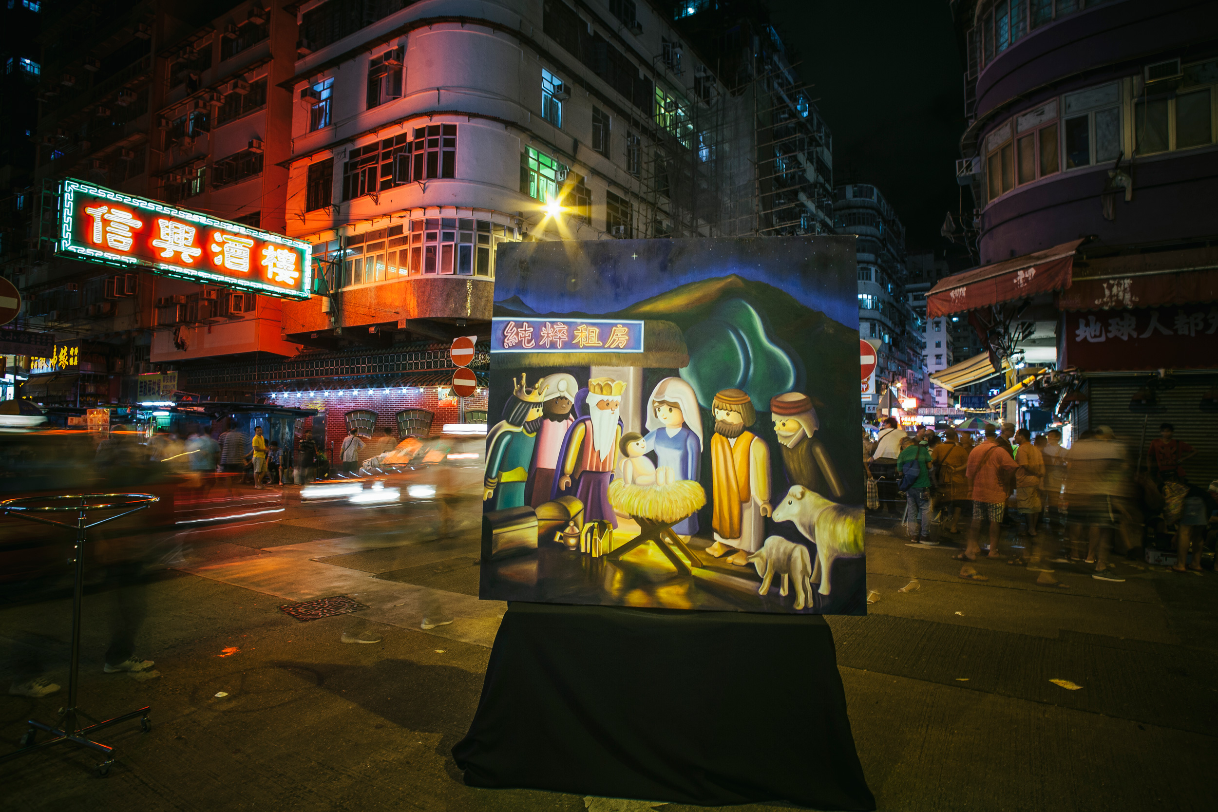 I brought the painting to Shum Shui Po in the middle of summer. The heat helps us to think outside the stereotypical feelings about Christmas.