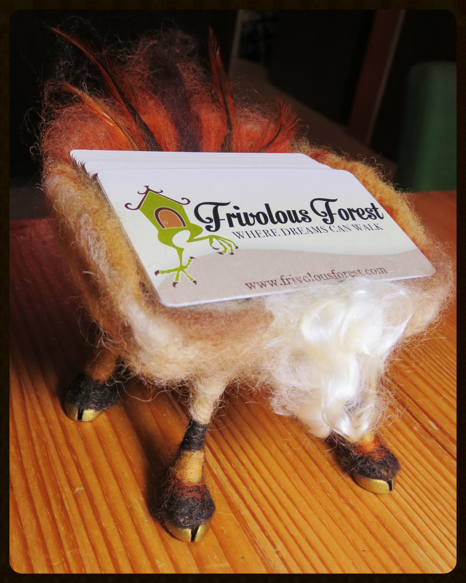 This creature with hooves and feathers has obligingly agreed to carry my cards for me.