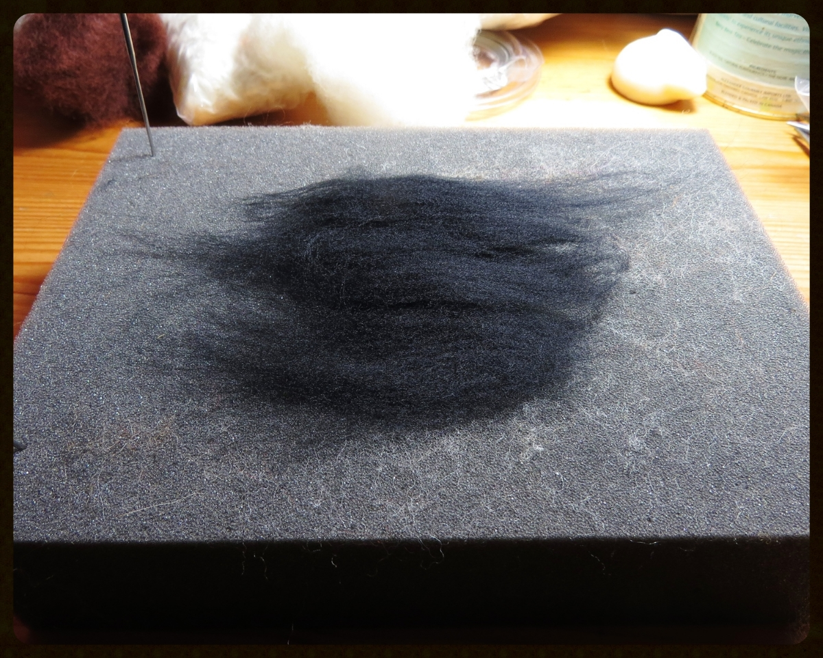 1. Lay out a very thin layer of wool with the fibers all going the same direction. Make sure there are no obvious gaps in the fibers.  (Look, there's one of  Sarafina Fiber Art 's lanolin bunnies! I'm going to need it for my hands after I use so muchdish soap.)