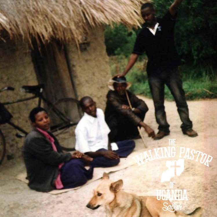 Kusasira praying over people at a village in Uganda