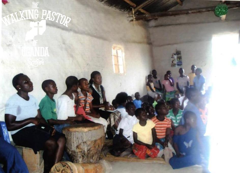 Kusasira preaching the Word of God at a Ugandan village