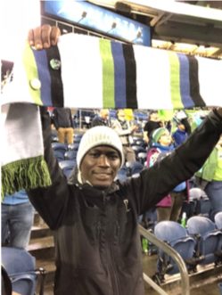 Ladji rooting for the Seattle Sounders soccer team.