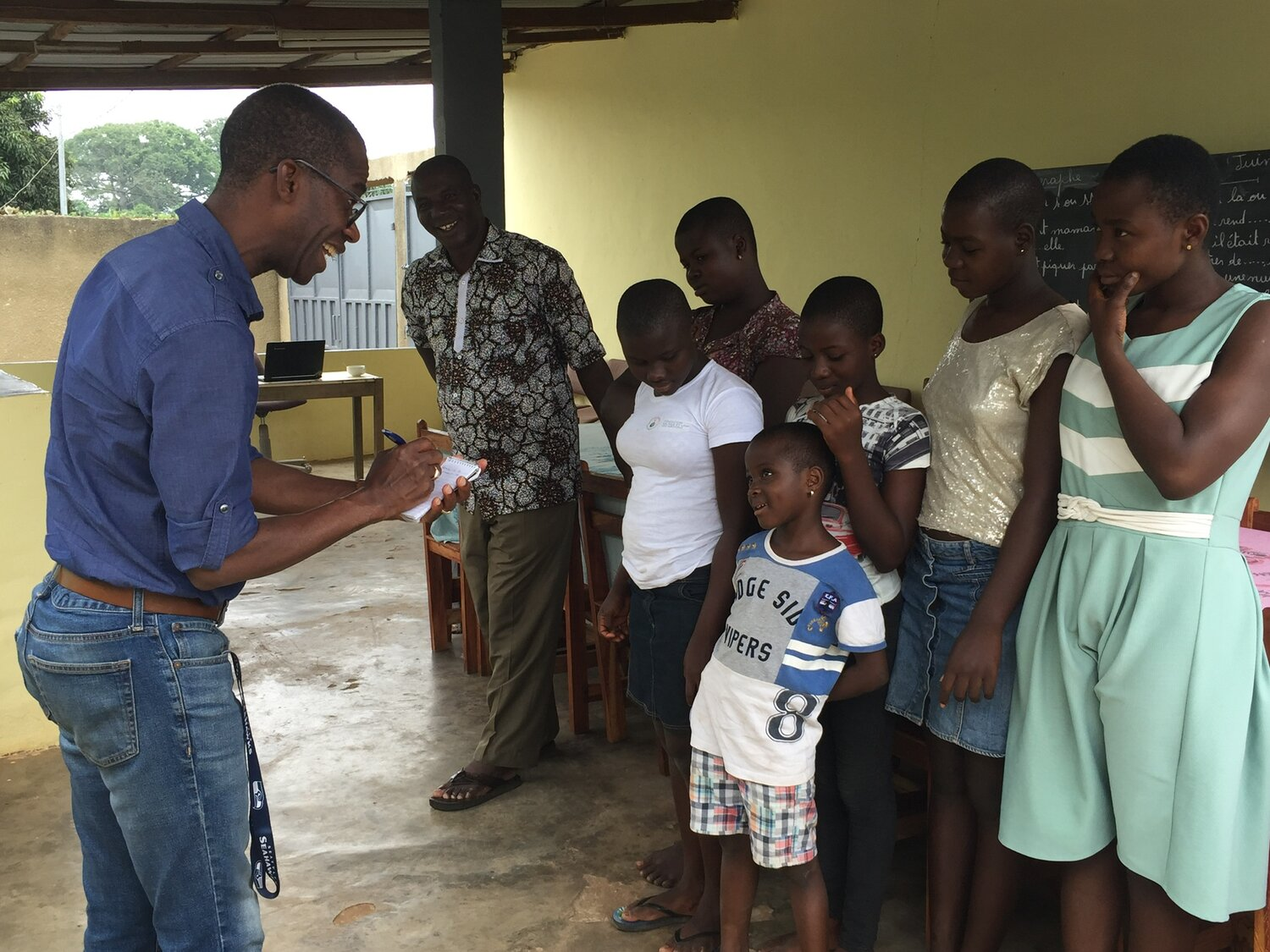 Sekou (left) speaking with some of the children at the orphanage and Father Germaine