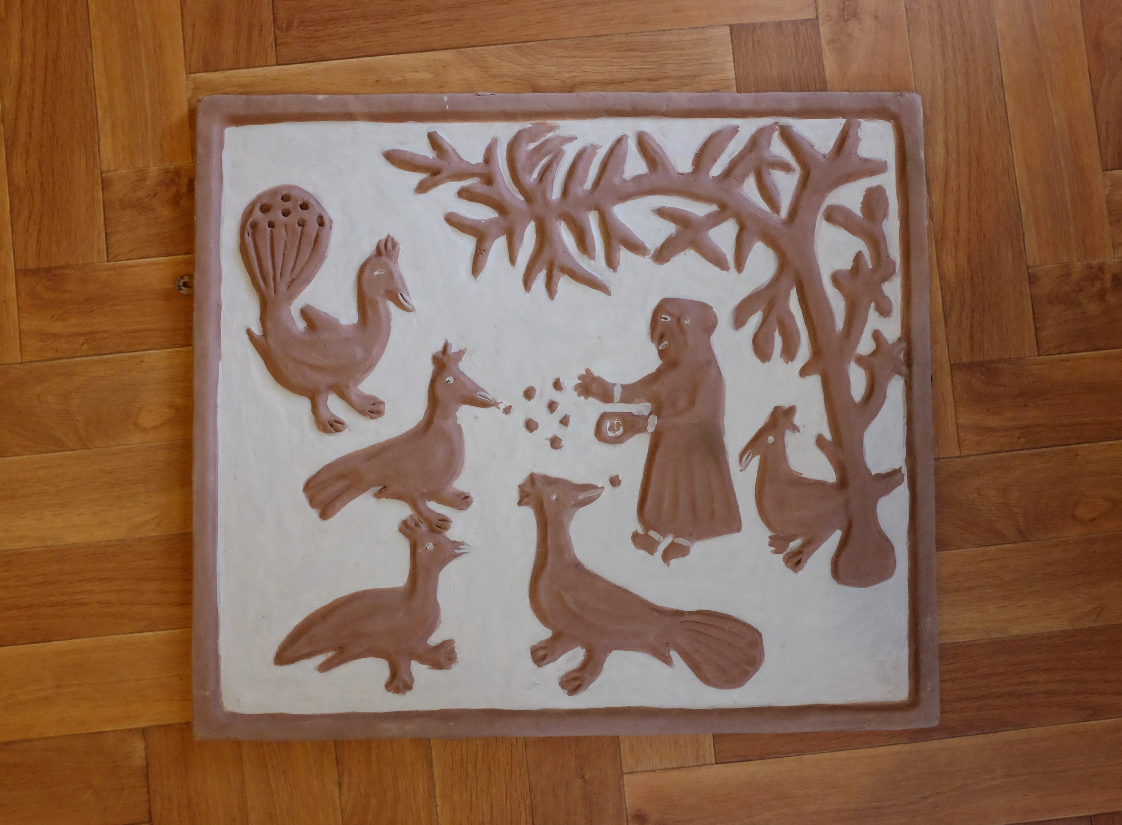 Photograph of a clay relief by Mrs Ranjit Dhanjal taken on an archive home visit.