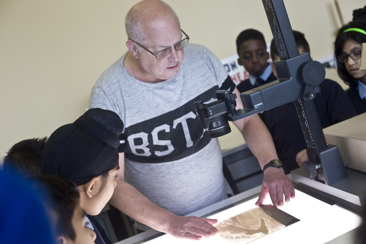 Pupils learn how photographic glass plates (over 100 years old!) are being photographed and digitised for an archive.
