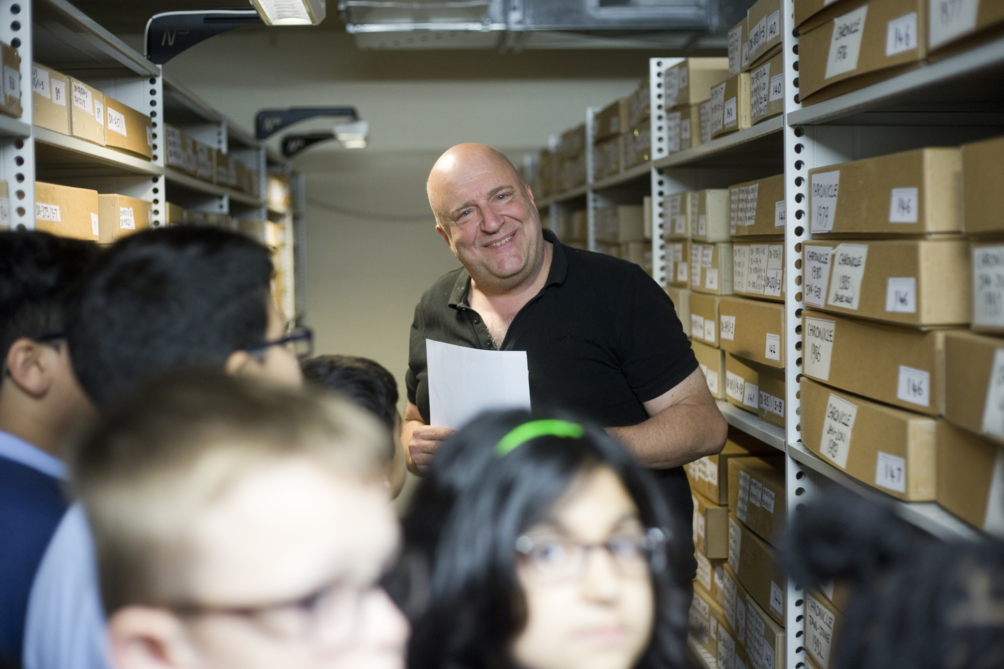 Jon Everall senior conservationist at City Archives takes pupils on a tour of the Strongrooms.
