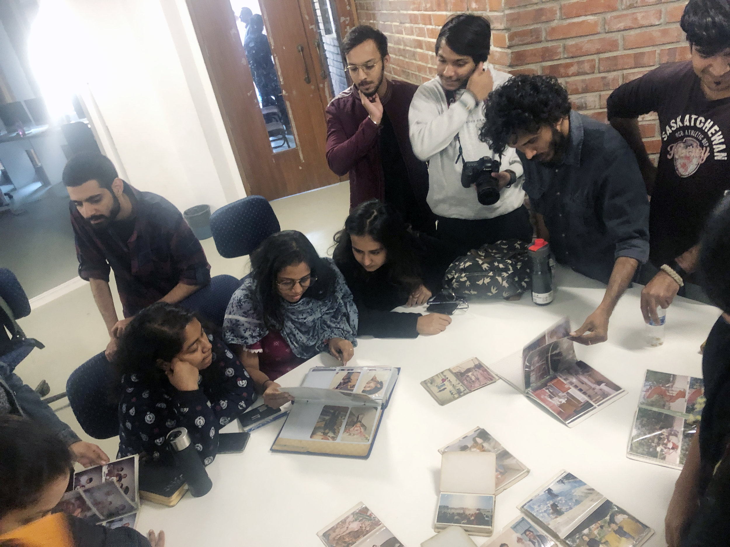 NEW DELH I- Students at Sri Aurobindo Centre for the arts spend time absorbing each others family albums from c1990s. Anand Chhabra conducted a workshop and presentation session about the archive with the first year students who come from all over India for over 3 and half hours.
