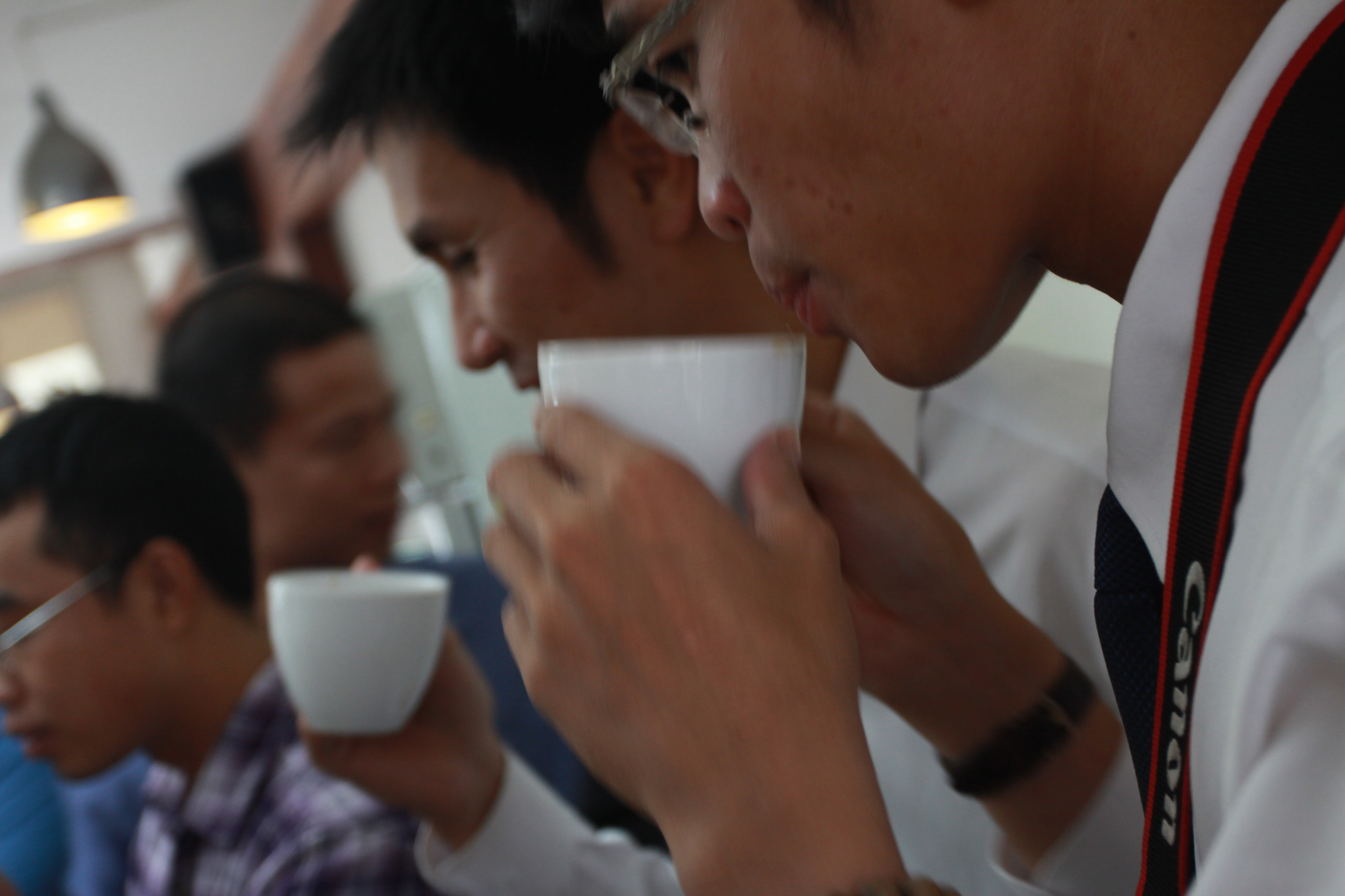 "Quang and Duy of Golden Bell sip at A Cafe's ""The Journey of Coffee,"" which featured coffees from Vietnam, Laos, Indonesia and India."