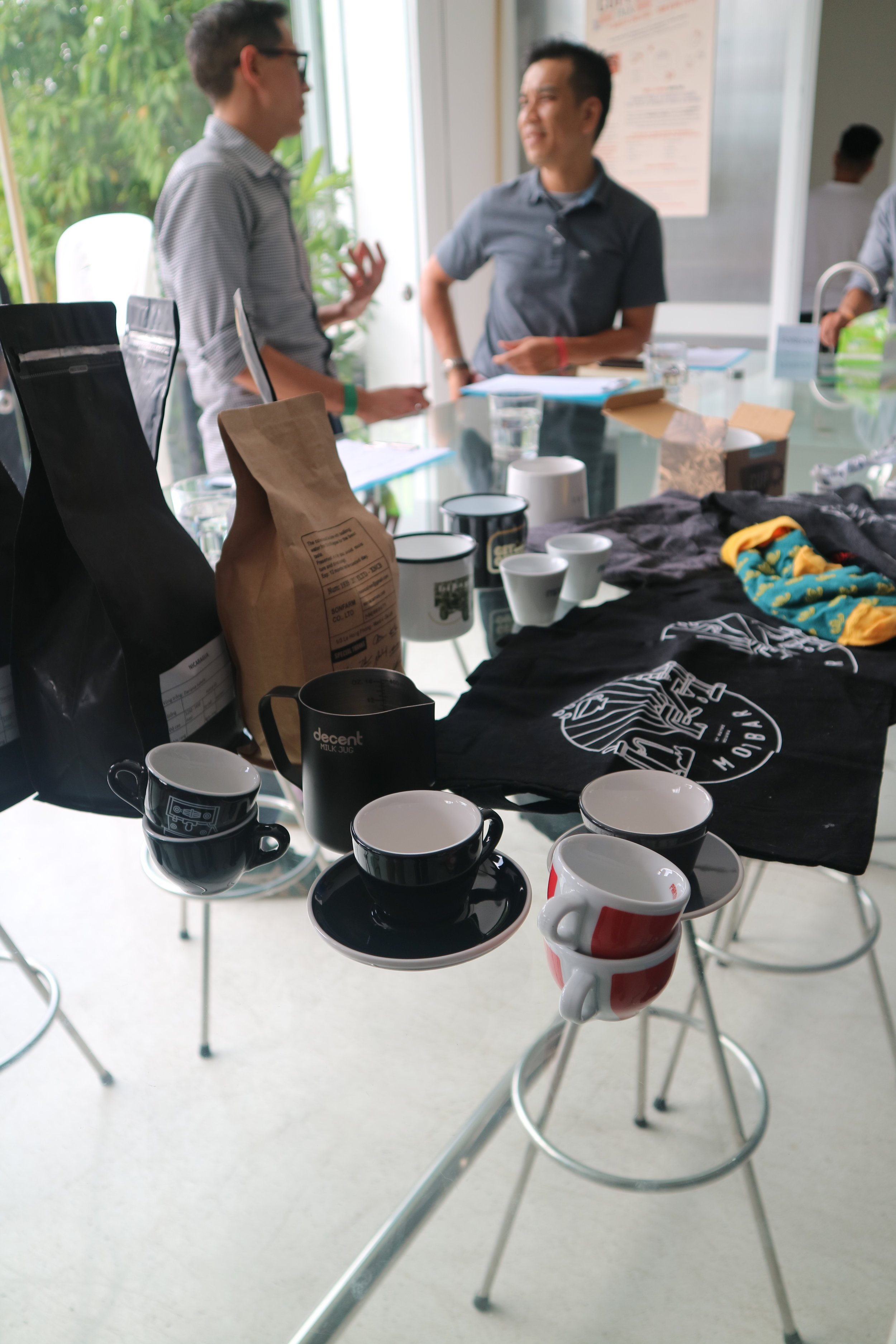 Me, Hung (Bosgaurus), and a table full of swag and prizes, including 1 kilogram of Panama Hartman Geisha.