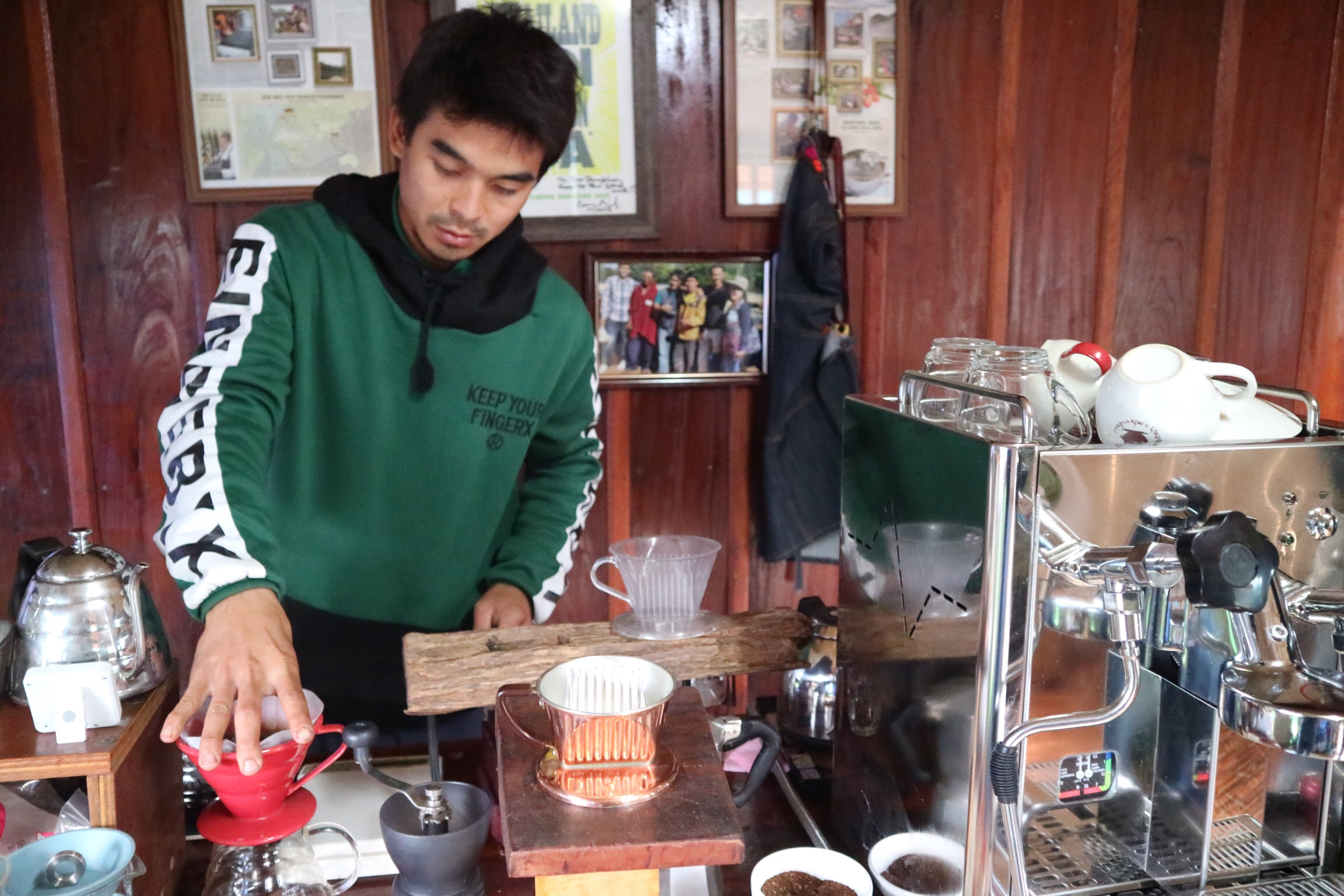 Ata, a Pangkhon area grower and innovator, in his personal cafe. He hosts visitors for homestay and farm tours, complete with unmatched warmth and hospitality.