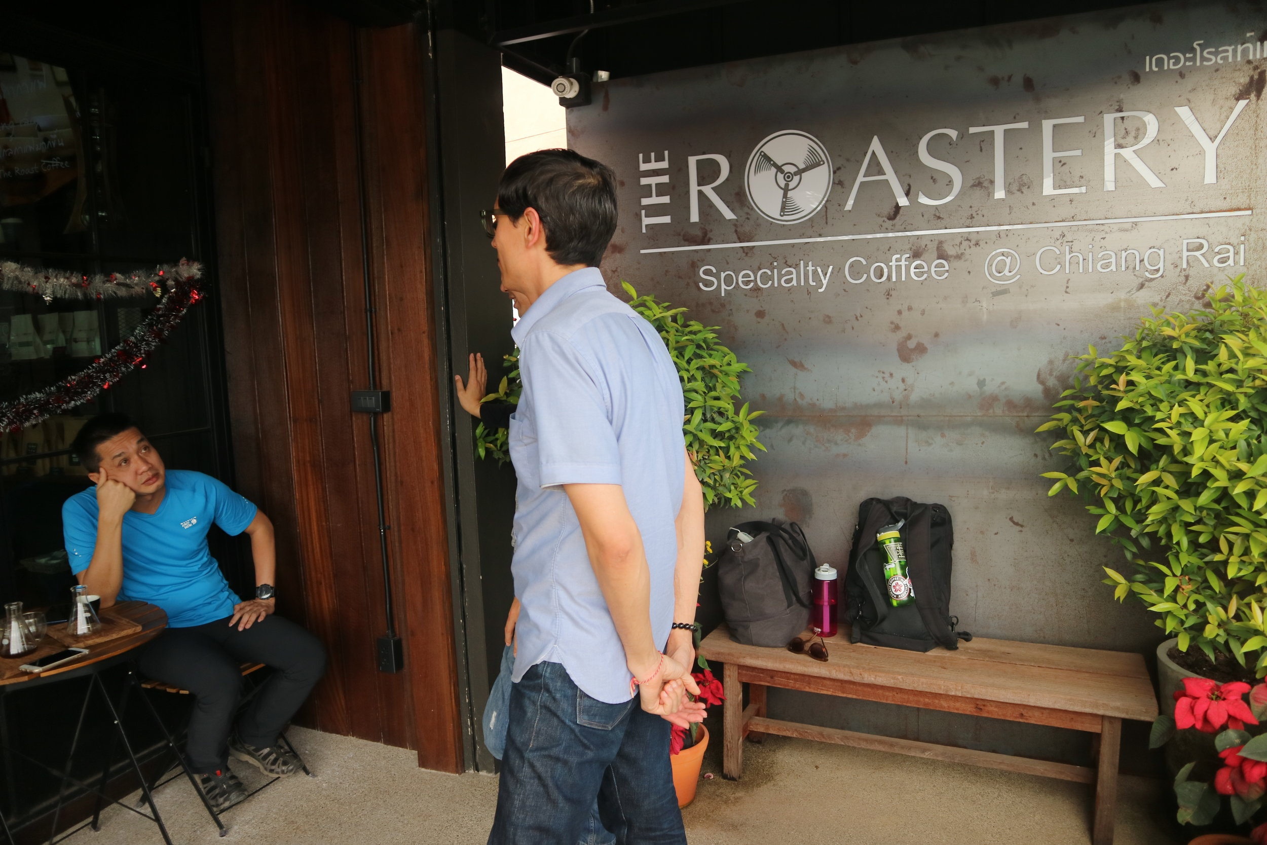 Yours truly arriving at The Roastery by Roj to a familiar face (Dung Nguyen of Saigon's The Workshop Specialty Coffee)