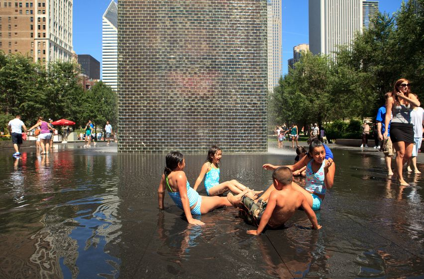 Visitors enjoying the Crown Fountain in Millennium Park in downtown Chicago. (Photo: fotoluminate)