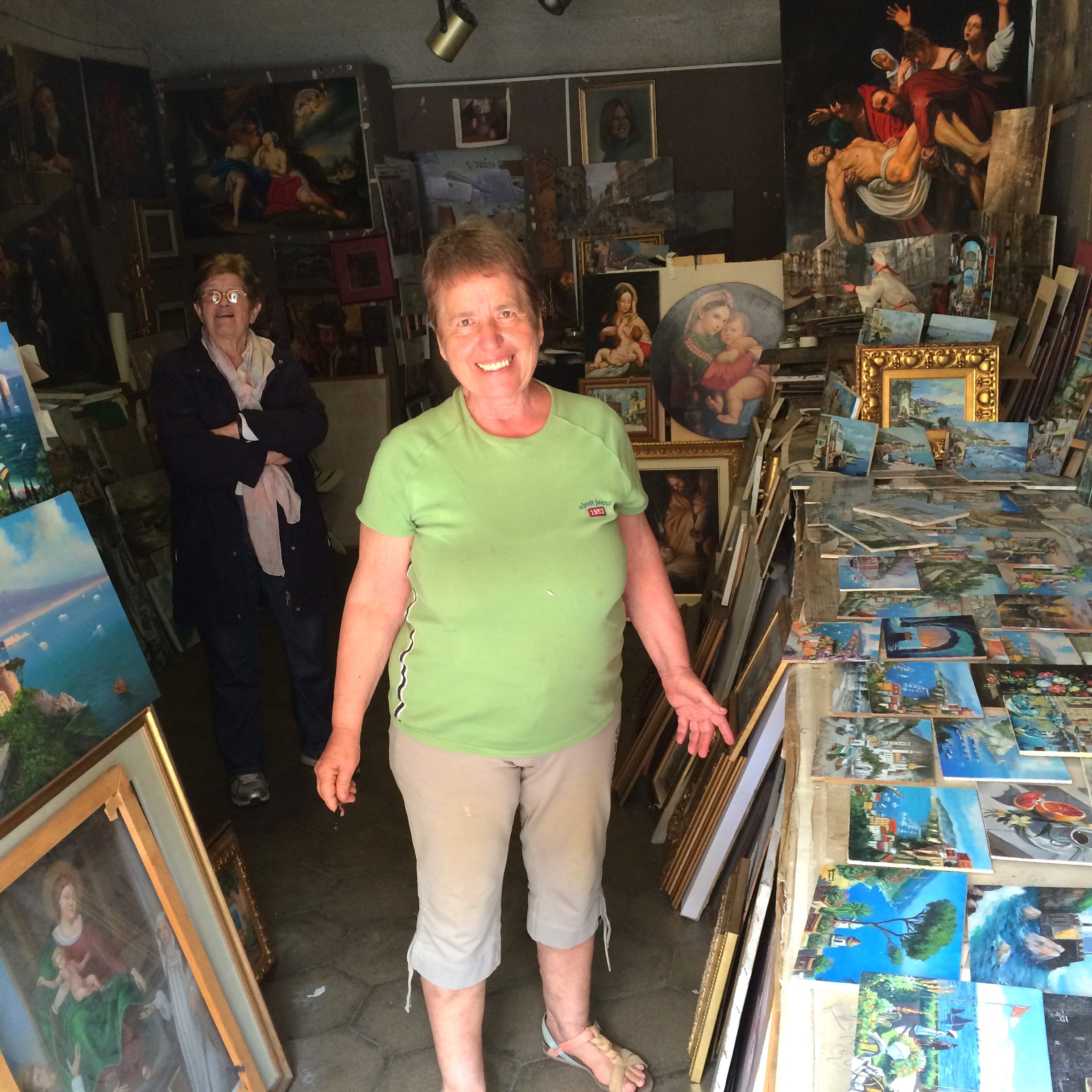The beaming artist herself, in her studio. That may or may not be her mother in the background.