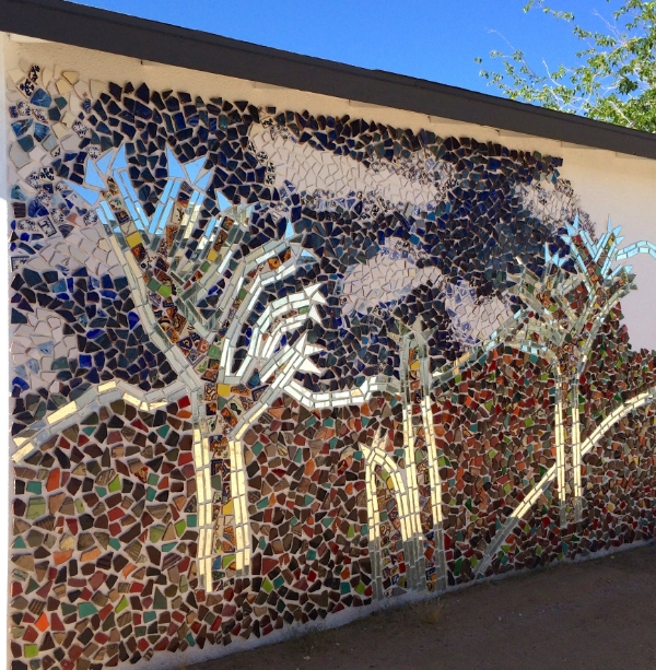 Colleena's creating this mosaic masterpiece on the exterior wall of the recording studio, which looks onto the backside of the main house.