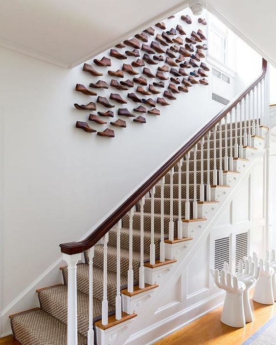 An ascending installation of vintage wood shoe forms.