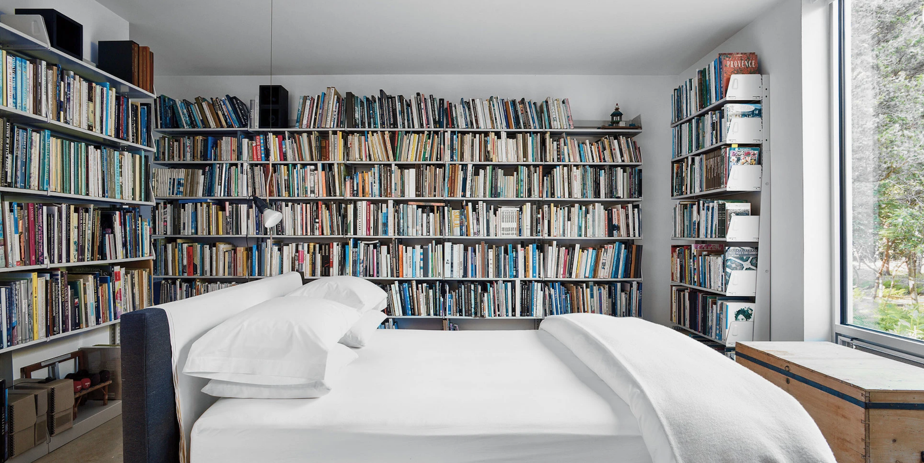 A bibliophile's dream bedroom, belonging to artist Jack Ceglic and architect Manuel Fernandez-Casteleiro.