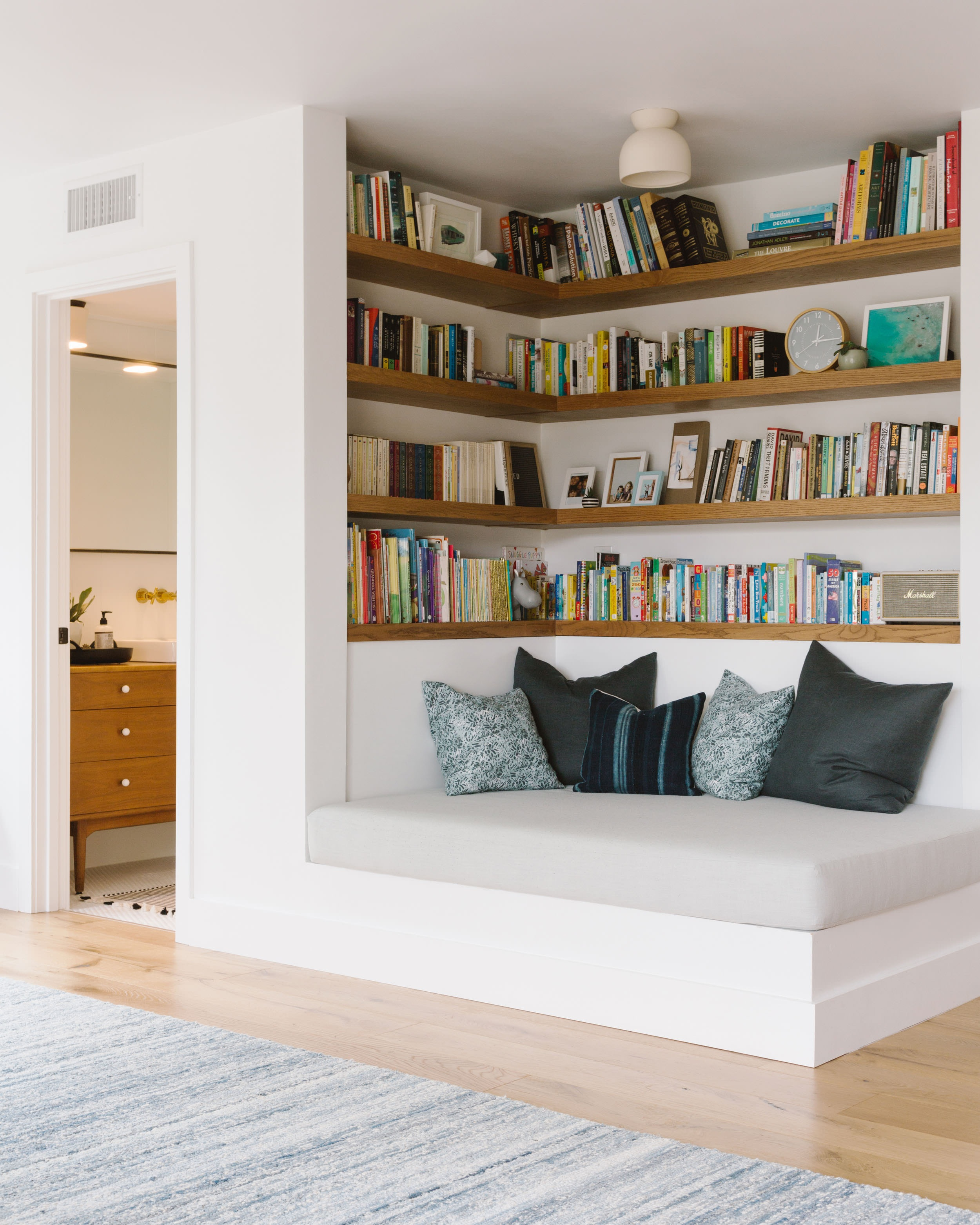 Reading nook utilizing an otherwise blah corner by  Samantha Gluck Interiors .