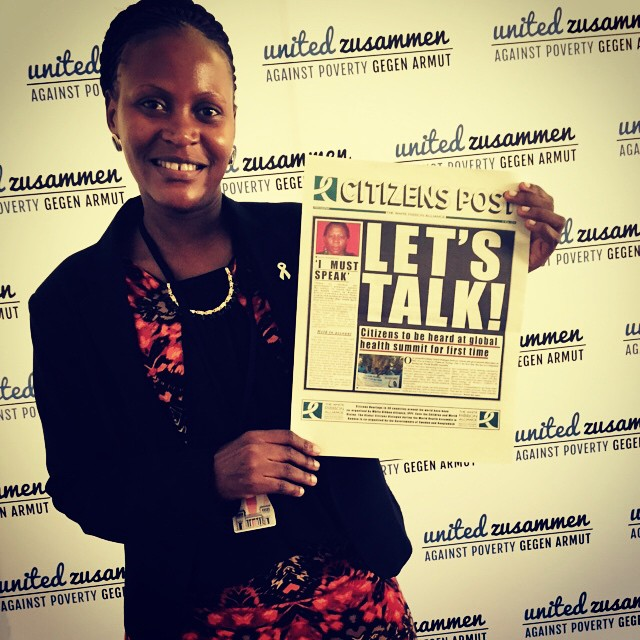 FARIDAH HOLDS THE SPECIAL EDITION CITIZENS POST