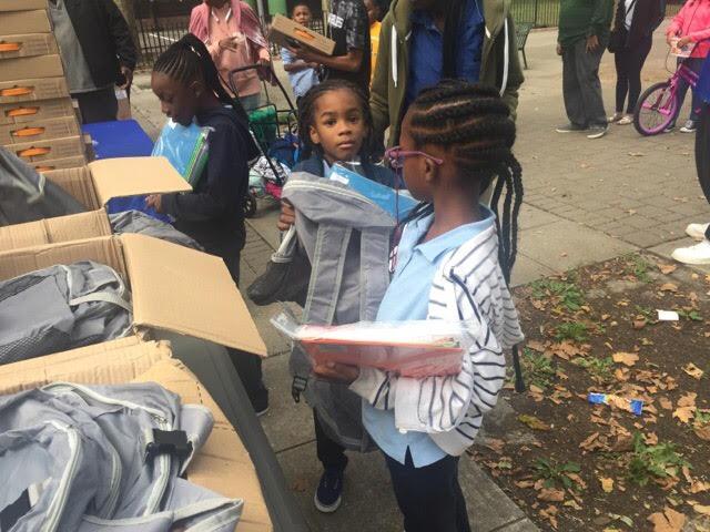 Kid Receiving school supply.jpg
