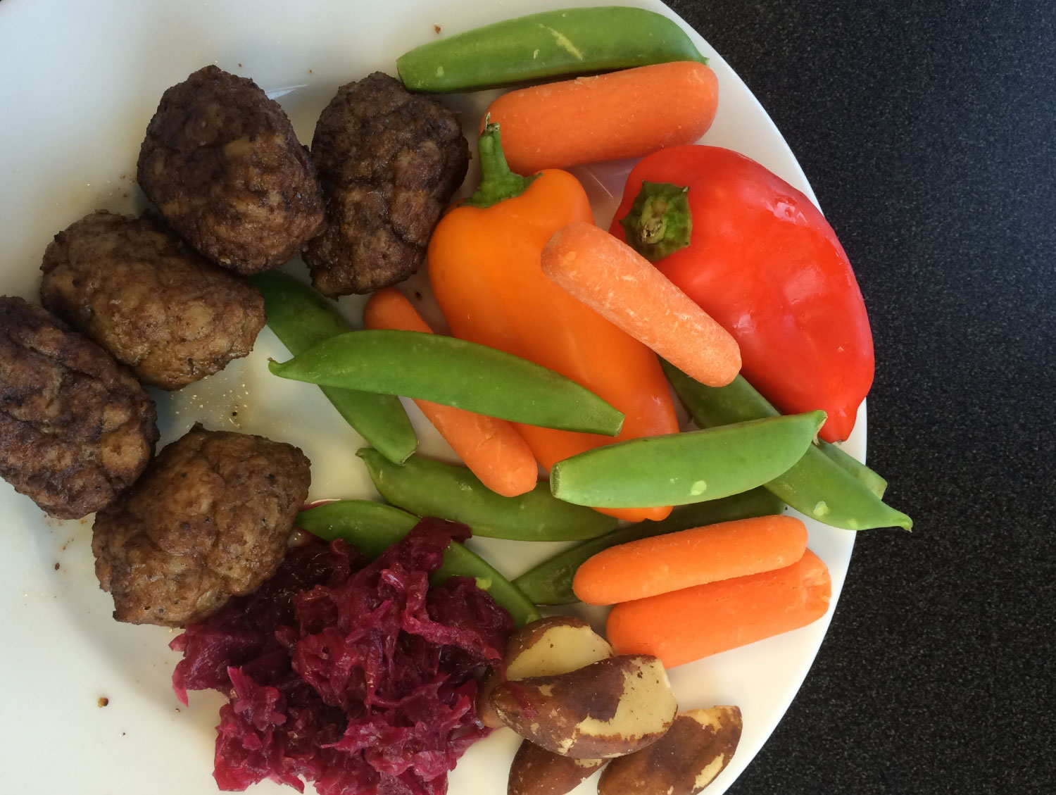 Chicken Meatballs, Raw Veggies, Brazil Nuts, Beet & Ginger Sauerkraut