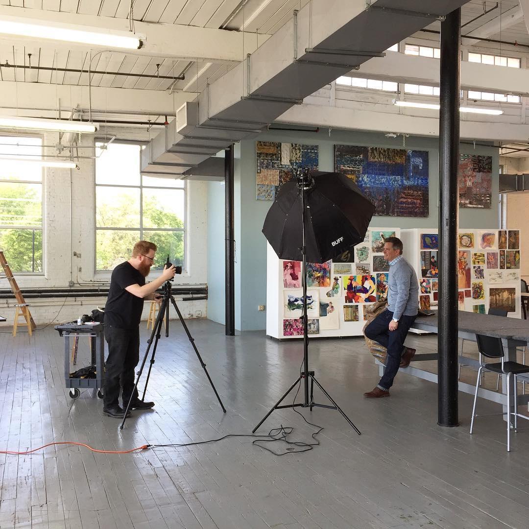 Eli Warren  taking headshots for fiber artist Travis Seward