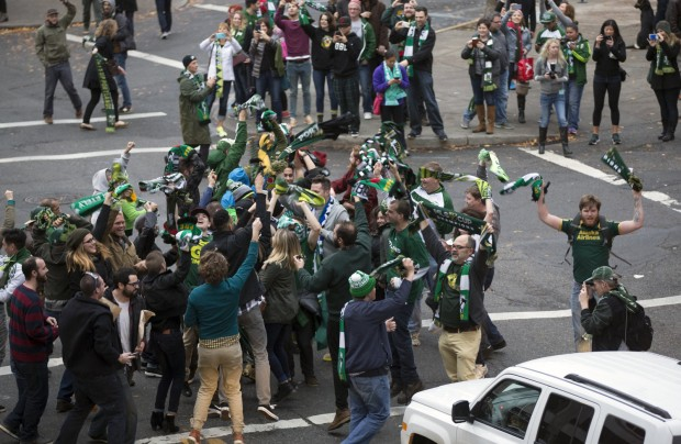Timbers fans celebrate despite the knowledge of only being a great team in a horrible league. Photo Credit: The Oregonian