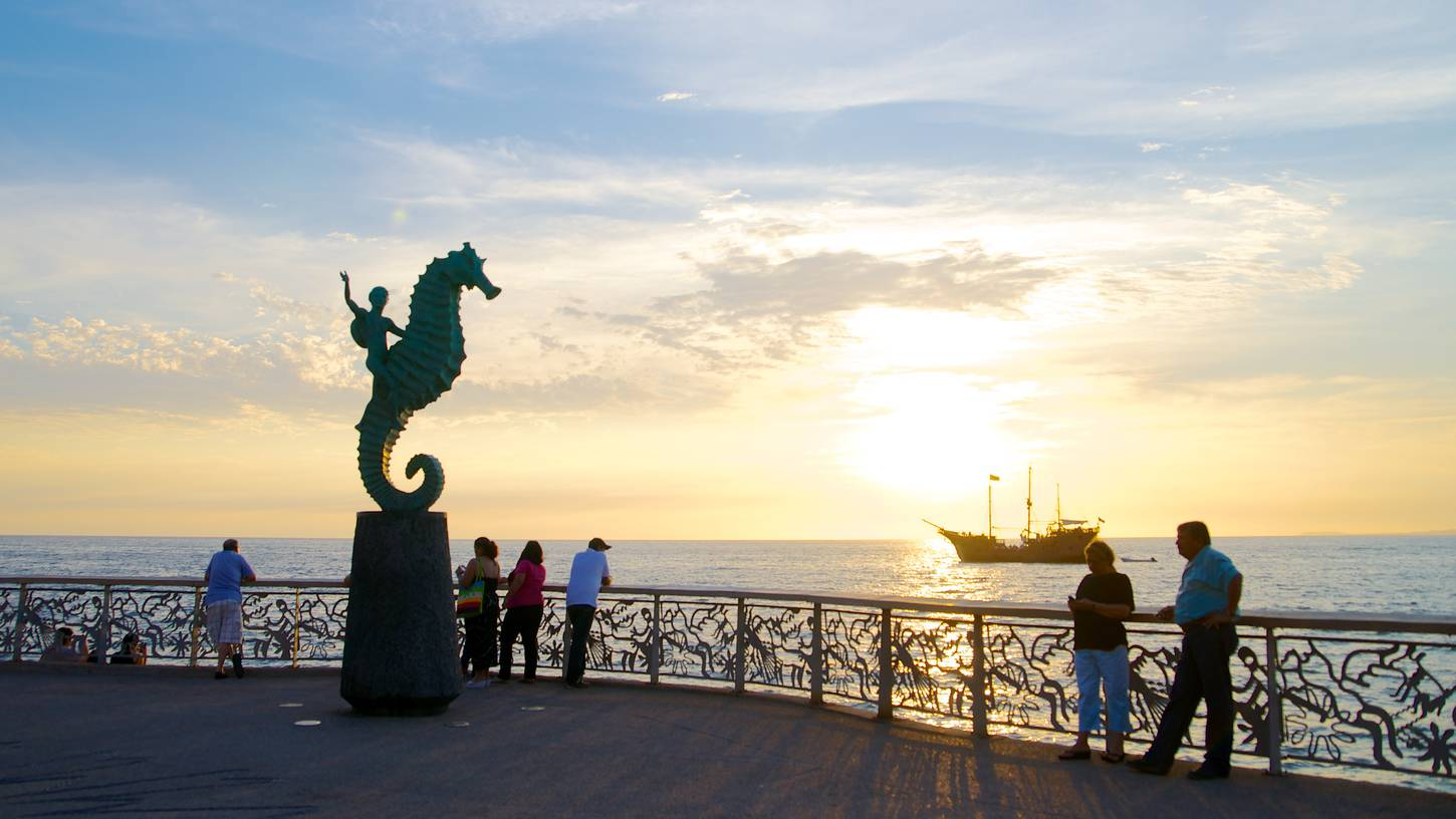 He died as he lived, by taking pictures of statues of seahorses.