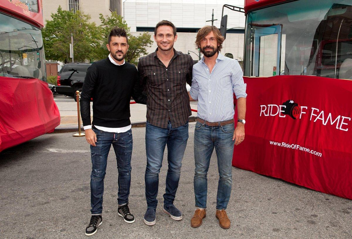 Area man inducts NYCFC Designated Players David Villa (l.) and Andrea Pirlo (r.)  into the Ride of Fame Tuesday (D DIPASUPIL/GETTY IMAGES FOR RIDE OF FAME)