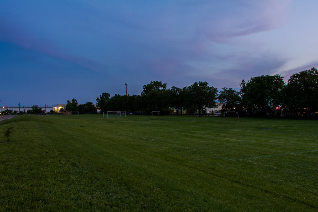 """""""An immense crowd here tonight as the fan pours into the grounds ahead of the matchup.""""  Photo by: Don Harder"""