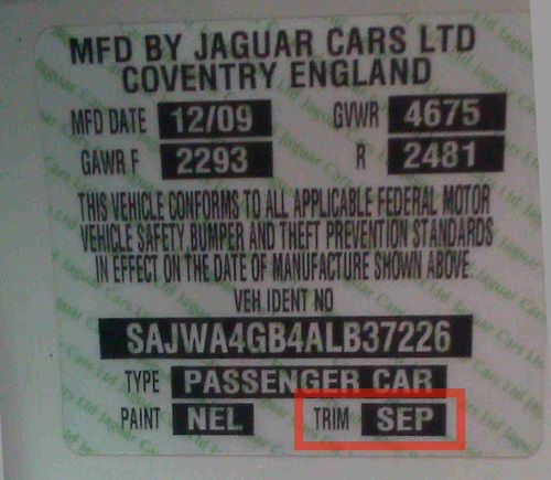 Jaguar keeps an interior trim sticker either on the underside of the hood or on the driver's side door pillar.