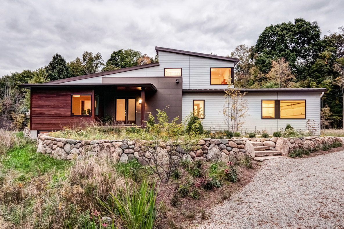 Custom modern home design with views of the landscape.